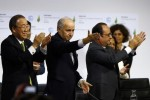 French President Francois Hollande, right, French Foreign Minister and president of the COP21 Laurent Fabius, center, and United Nations Secretary General Ban ki-Moon applaud after the final conference at the COP21, the United Nations conference on climate change, in Le Bourget, north of Paris, Saturday, Dec.12, 2015. Governments have adopted a global agreement that for the first time asks all countries to reduce or rein in their greenhouse gas emissions. (AP Photo/Francois Mori)